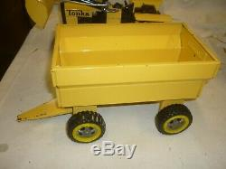 A Vintage Tonka toys Canada, front loading tractor & trailer, boxed